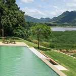 the hotel villa ban khoy river view of the meking - swimming pool and garden of the villa for rent per week or per day in luang prabang lao pdr